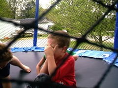 James crying (ann_blair2003) Tags: blue boy red children crying trampoline