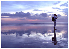 Waiting for a moment (^riza^) Tags: sunset bali beach photographer 2006 kuta indonesiaphotobloggers thebiggestgroup
