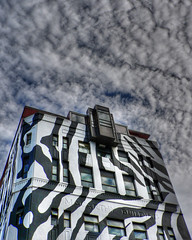 zebra architecture (Brenda Anderson) Tags: newzealand sky white black building architecture clouds stripes painted wellington hdr curiouskiwi pse3 3xp photomatix hdart flickrmeet24apr06 imagekind wellingtonflickrexhibitpotential brendaanderson ourspacenz submittedtoourspace curiouskiwi:posted=2006