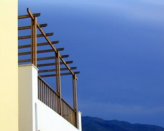 Blue & Yellow on Crete (MaureenShaughnessy) Tags: travel blue sky white abstract color building yellow architecture mediterranean geometry angles greece 2550fav crete utata topf simple stucco pergola elemental notsaturated straightfrommycamera awesomeplaceonearth utatablue seasonalrhythmslight