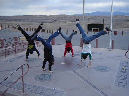 handstands at four corners