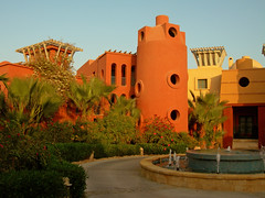 Sheraton Miramar Resort El Gouna, Hurghada - Egypt (mnadi) Tags: flowers sunset red summer vacation sky orange holiday flower colour garden hotel warm colours outdoor redsea curves egypt sunny el resort arabic clear gouna egyptian styles sheraton ethnic spa miramar hurghada michaelgraves bedouin  nubian elgouna bougainvilleas