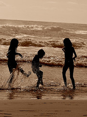 Ash, Sarah & Luke splashing beach - sepia (Earlette) Tags: morning summer beach water silhouette kids children fun surf waves australia kicking goldcoast splashing