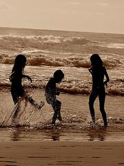 Ash, Sarah & Luke splashing beach - sepia (Earlette) Tags: morning summer beach water silhouette kids children fun surf waves australia kicking goldcoast splashing