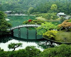 (James Disley) Tags: park travel bridge green japan digital lumix japanesegarden spring asia greenisbeautiful 2006 shikoku takamatsu  kagawa   dmcfx7   jetprogram jetprogramme   ritsurinpark  panasoniclumix  ritsurinkoen jamesdisley lumixdmcfx7    favoritegarden