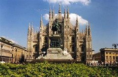 The Cathedral, Milan, Italy (Thad Roan - Bridgepix) Tags: plaza blue sky italy sculpture milan building church statue architecture clouds square europe cathedral gothic landmark lampost wikipedia piazza duomo 200109 duomodimilano lombardy italy2001 piazzadelduomo