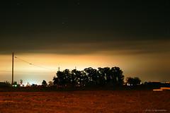 Barrenness (aaronwtong) Tags: longexposure trees light sky mystery night dark stars rocks quiet moonlight slowshutterspeed barrenness