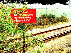 Places Pass Through You (Lady Vervaine) Tags: uk red england travelling green sign tag3 taggedout train warning outdoors tag2 tag1 britain text tracks railway line saturation rails trespass penalty rambling thebegoodtanyas thelittlestbirds whoareoneofthegreatestbandsintheworldtoday seriouslytheyarecheckthemout wooyouvegotthetagbugiloveit