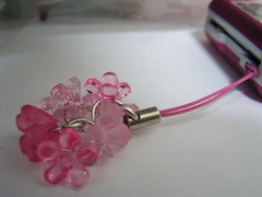 Pink phone charm with flower theme (shimmertje) Tags: pink flowers light hot interestingness jump flickr acrylic phone 4 charm plastic clear explore rings donuts faceted frosted lucite
