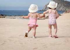 off they go... (sesame ellis) Tags: girls friends cute beach walking children mexico kid cabo child hats mykid notmykid frombehind year2 holdinghands toddlers theonewhomoved tc48hats