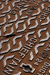 chieftain (Adam Clutterbuck) Tags: uk greatbritain orange brown 20d metal rust canoneos20d drain gb manhole oe greengage adamclutterbuck showinrecentset openedition