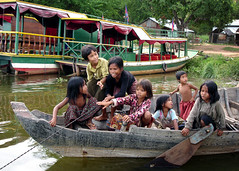 Tonle Sap: Rockin' the boat (mboogiedown) Tags: poverty travel lake cute kids children asian boat interestingness asia cambodian khmer culture impoverished southeast siemreap  mekong cultural sap greatlake developingcountries tonlesap waterworld tonle  kampuchea mapcambodia  camodia cambogia theravada interestingness397 i500 travelforpeace floatingvillages  51106 khmeer developingnations susday suksabaychete asiasgreatlake underpriviledged hopeforthefuture  camboge beatravelernotatourist dontjustseetheworldexperienceit experiencecambodia buddhistnations girlfriendsandbabies
