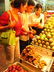 buying fruits at a Saigon night market (adlaw) Tags: travel food colors fruits night market vietnam saigon hochiminh tambis starapple roseapple makopa mommyletty