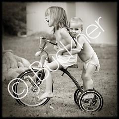 Giggles (EightJs) Tags: topf25 kids laughing children fun tricycle 100v10f 500v50f 1000v100f topf90 nikonstunninggallery exploretop20 abigfave