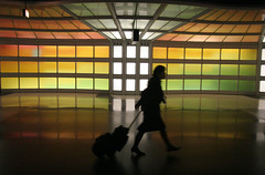 O'Hare Silhouette (Crickontour) Tags: show travel light woman chicago bag underground airport movement body wheels flight terminal ohare international language transfer ord concourse unitedairlines favcol