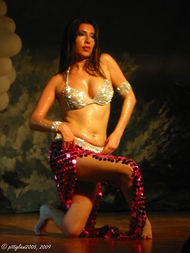 A dancer performing Raqs Sharqi - Arabic Belly Dance