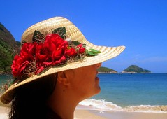 A girl with a hat full of  stars and flowers (neloqua) Tags: ocean blue light sea summer brazil woman sun sunlight beach southamerica water girl beautiful hat riodejaneiro wonderful wonder fun happy daylight amazing fantastic perfect colorful great joy adorable sunny bluesky bleu excellent summertime moment lovely charming magical niteroi sunnyday