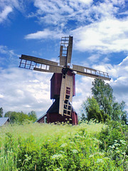 Windmill (Sameli) Tags: cameraphone blue trees red summer sky cloud building tree green mill nature windmill grass clouds buildings suomi finland happy wings warm europe skies k750i wind wing meadow meadows scene k750 grassland grasslands vaasa rakennus