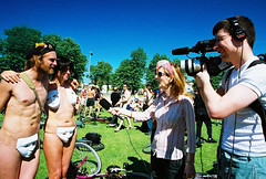 john and yvonne (lomokev) Tags: camera summer people canon john tv media brighton mask body sunny yvonne masks agfa interview ultra agfaultra eos1 circularpolarizer worldnakedbikeride nakedbikeride thelevel canoneos1 rudebits brightonnakedbikeride brightonworldnakedbikeride upcoming:event=46171 file:name=cnv00146 johnsc flickr:user=yvoluna flickr:nsid=13520439n07