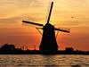sunset with mill and heron (hans s) Tags: sunset orange mill heron water alphenaandenrijn fcsetsrises