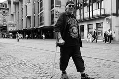 Dirty Deeds (nigelhunter) Tags: street hat sunglasses walking dc candid dirty strasbourg stick ac cobbles deeds