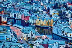 City of Alesund in Norway (pmocsonoky) Tags: street travel blue houses sea summer sky urban panorama house mountains reflection art tourism nature beautiful architecture night port landscape outdoors island coast town twilight europe european cityscape view background scenic landmark panoramic illuminated norwegian coastline fjord scandinavia scandinavian alesund