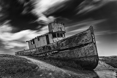 The Lady of Tomales Bay (eCHstigma) Tags: california longexposure blackandwhite abandoned monochrome clouds boat nikon ship gloomy outdoor decay neglected windy tokina shipwreck worn bayarea d750 weathered sfbayarea derelict bnw inverness pointreyesnationalseashore 16stop