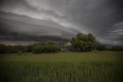 Small Town Storm (Lori Bote) Tags: summer storm hail thunderstorm saskatchewan storms prairies stormclouds summerstorms abandonedbuilding supercell wallcloud