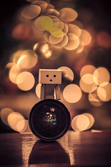 Danbo sitting on the Tokina 16-28 lenses. (Vagelis Pikoulas) Tags: danbo bokeh canon tokina 1628mm 6d tamron 70200mm vc f28 light lights night indoors 2016 christmas