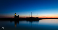 Howth 21Jan17 4-2 (Helen Mulvey) Tags: howth dublin ireland sea coast harbour water reflection sunrise dawn lighthouse pier silhouette blue sun outdoor seascape landscape boast nikon d5100 calm waters panorama tripod 365 21365