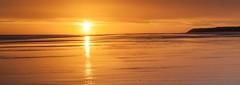 Sunrise Reflections, Pano (Carl Mick) Tags: reflections eastcoast northeast robferrol ngc seascape travel castle sunrise northumberland bamburghsunriseseascapecastle sky