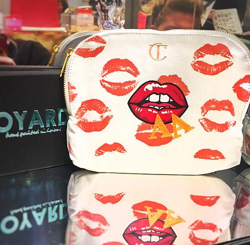 Badge lips aa charlotte tilbury makeup purse