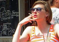 People in Venice 013 - Relaxing at a cafe (Row 17) Tags: city venice people urban italy woman women italia streetlife streetscene smoking smoker venezia streetfashion veneto