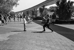 Action Shot (bhop) Tags: california leica blackandwhite bw film canon 50mm kodak iso400 disneyland f14 trix rangefinder tourist disney 400 anaheim m6 premium themepark screwmount arista v700 filmisnotdead threadmount