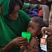Hosma Mohammed a mother of Amin Amirah checking for Severe Acute Malnutrition (SAM) at Lubakda Kebele of Kori Woreda in Afar Regional state.