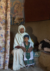 Portrait of an ethiopian monk woman with an orphan girl inside a house, Amhara region, Lalibela, Ethiopia (Eric Lafforgue) Tags: abyssinia adult africa africanculture africanethnicity africans amhararegion ashetenmariam ashetonmaryam child christianity clothing colourpicture curtain day developingcountry eastafrica ethio17596 ethiopia ethiopians girl hornofafrica house lalibela lookingatcamera maria monastery monk oneperson orthodox people photography portrait realpeople religious room ruralscene semienwollo shawl traditionalclothing twopeople vertical woman women