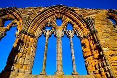 Window (rustyruth1959) Tags: nikon nikond3200 tamron16300mm yorkshire whitby whitbyabbey abbey ruins window arch architecture stonework building structure church nave aisle northaisle westend sky blue outdoor columns 14thcentury monastery sunlight