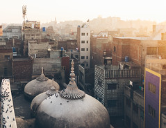 Sunset over Lahore (Nuzhat Aziz) Tags: lahore pakistan travel sunset oldcity old city buildings mosque domes wazirkhanmosque light evening