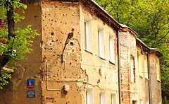 Warsaw's Praga District. Bullet holes from 1944 fighting. (slowsteady4559) Tags: old travel history tourism army war europe apartments poland praga 1940s soviet warsaw conflict renovation eastern 1944 bulletholes uprisig
