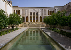Reflections Of Manouchehri House On Water Pools, Isfahan Province, Kashan, Iran (Eric Lafforgue) Tags: travel house building tourism water horizontal architecture vintage outdoors photography hotel persian pond asia day iran middleeast persia nobody nopeople courtyard palace basin historic east iranian sight oriental orient kashan luxury kachan islamicarchitecture elegance destinations basins traveldestinations إيران prestigious иран colourimage イラン irão isfahanprovince iranianculture 伊朗 이란 historicalresidence iran150004