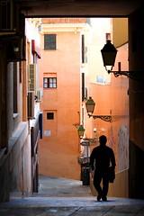Palma de Mallorca (Wackelaugen) Tags: street light man silhouette canon walking person photography eos photo alley walk explore lantern mallorca palma downstairs googlies palmademallorca explored wackelaugen