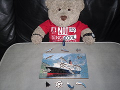 Jest my size! (pefkosmad) Tags: wentworth wooden whimsies jigsaw puzzle hobby leisure pastime minipuzzle queenelizabeth2 oceanliner ship vessel teddy bear tedricstudmuffin cute stuffed soft toy animal plush fluffy 77pieces complete used