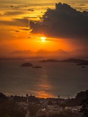 Okaara Bay (Diego S. Mondini) Tags: sunset orange clouds bay islands são sãofranciscodosul brasil brazil santacatarina pôrdosol mountains light ocean
