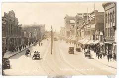 JASPER AVE LOOKING WEST (jasonwoodhead23) Tags: edmonton downtown jasper ave poles buildings