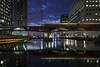 Heron Quay, Canary Wharf in the blue hour (Waving lights in the dark) Tags: london canarywharf wharf dock middledock dlr train tram bluehour dusk motion motionblur blur cwb frequent city citylights water reflection reflections bridge railway night sonya7 sonyzeiss sony docklands heron quay heronquay
