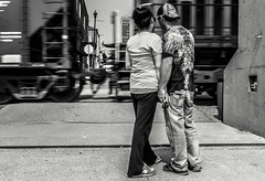 street-1000-4 (Eric Mattson) Tags: street blackandwhite bw couple streetphotography trains romance wait holdhands