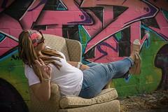 Peace (pdebree) Tags: girl pose graffiti cool chair pretty peace florida outdoor lounge springs fl fla tarpon tarponsprings