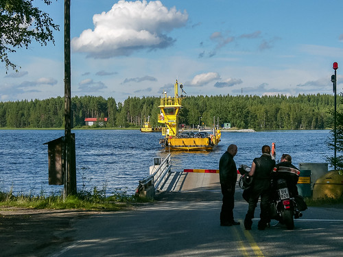 Bikers waiting for a cable ferry