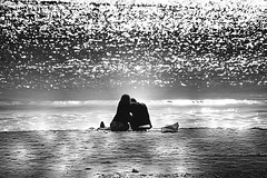 beach life (Wackelaugen) Tags: ocean light sea summer blackandwhite bw woman white man black beach water canon person photography eos mono photo blackwhite spain sand couple europe sparkle mallorca sparkling googlies sacoma illot wackelaugen