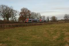 SNCF Class X 73500 railcar runs through Le Petit Trézy